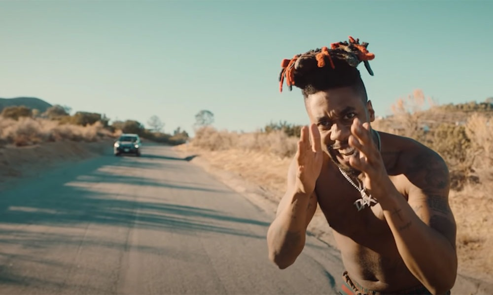 "Dax follows Trippie Redd collab with ""Rap God (Remix)"" video"